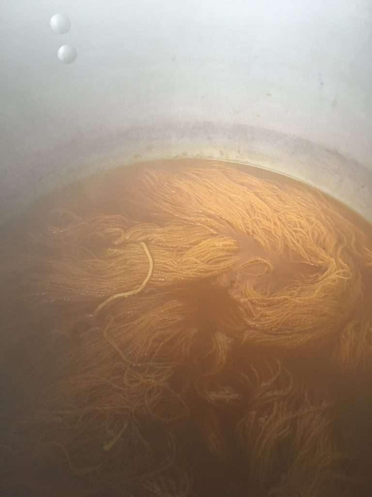 Dying yarn in a water bath on stove.